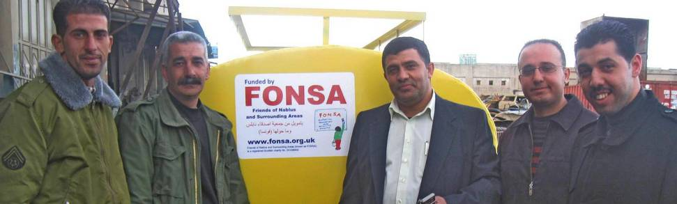 New FONSA water tanker for Burqa village with group of men
