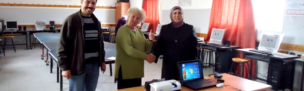Handing over new IT kit for Yatma village