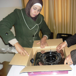Woman unpacking a new gas cooker